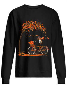 Cavalier King Charles Spaniel dog in fall dog riding bicycle shirt